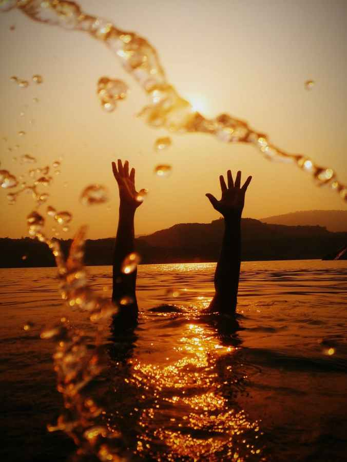 hands above water